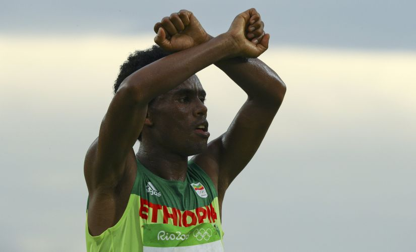 Feyisa Lilesa celebrates. Reuters