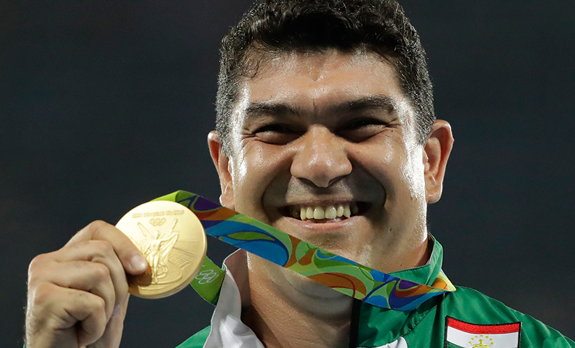 File photo of Dilshod Nazarov posing with his gold medal. AP