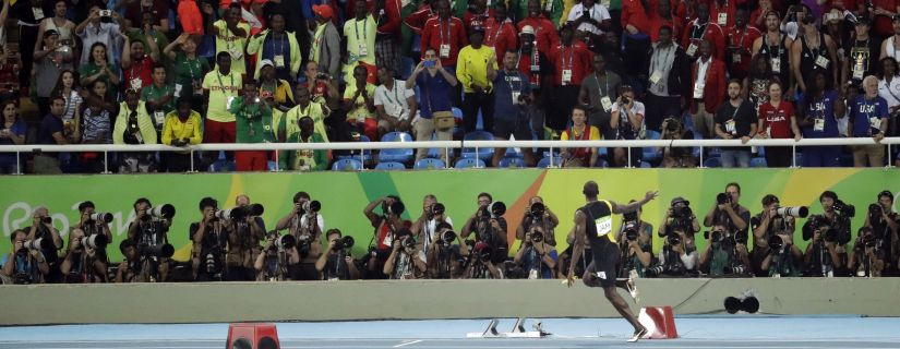 Usain Bolt celebrates after winning the men's 4x100-meter relay final. AP