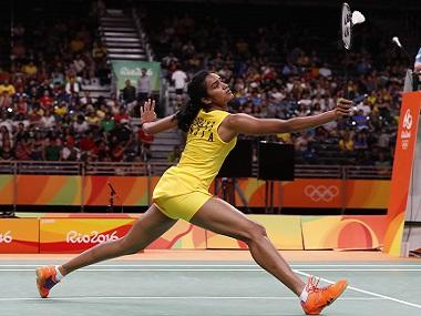India's Sindhu Pusarla return a shot to China's Wang Yihan during the Women's Singles Quarterfinal at the 2016 Summer Olympics in Rio de Janeiro, Brazil, Tuesday, Aug. 16, 2016. (AP Photo/Vincent Thian)