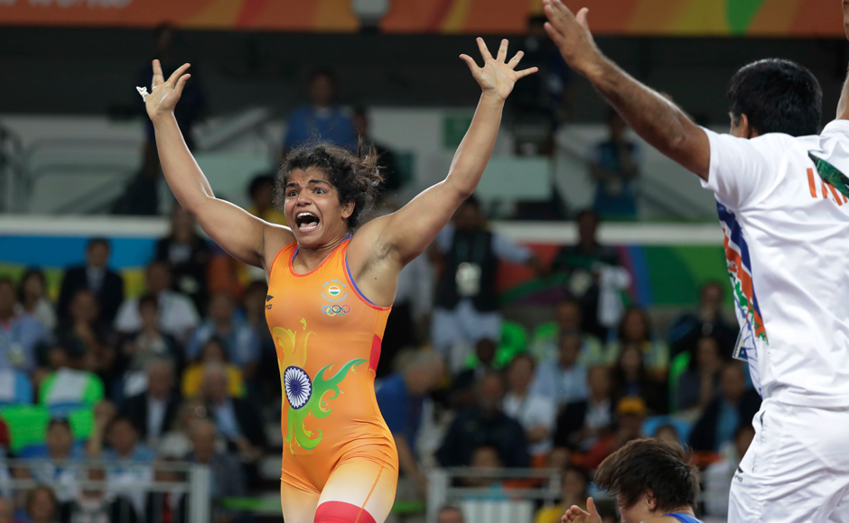 India's Sakshi Malik reacts after winning bronze against Kyrgyzstan's Aisuluu Tynybekova in the women's wrestling freestyle 58-kg competition. AP