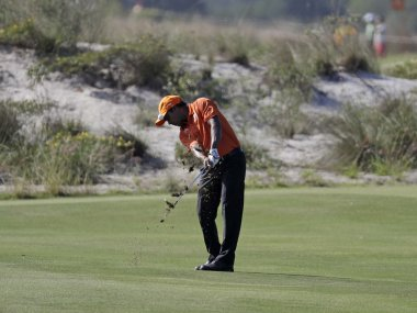 Shiv Chawrasia of India, hits from a fairway during the third round of the men's golf event. AP