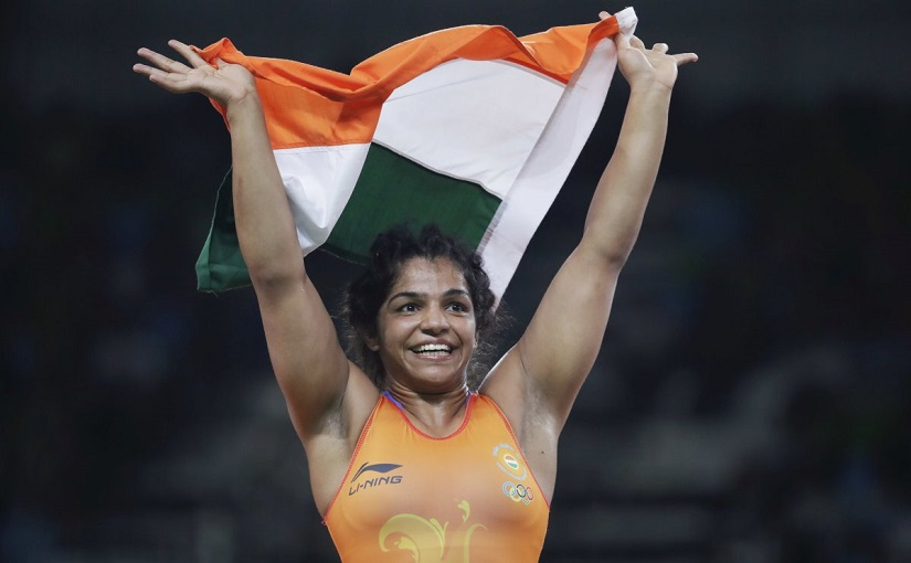 India's Sakshi Malik reacts after winning bronze against Kyrgyzstan's Aisuluu Tynybekova in the women's wrestling freestyle 58-kg competition at the 2016 Summer Olympics in Rio de Janeiro, adding to India's medal tally. AP