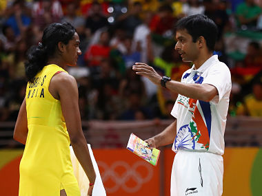 Gopichand with Sindhu during the Rio Olympics Final. Image Courtesy: FirstPost
