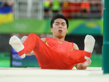 Chinese gymnast You Hao falls during the Men's parallel bars final. Reuters