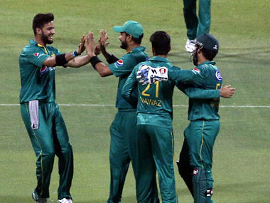 Pakistan's players celebrate taking a wicket during the third T20I against West Indies. AFP