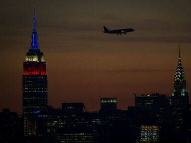 The Empire State building is lit in traditional red, white and blue to commemorate 9/11. Reuters