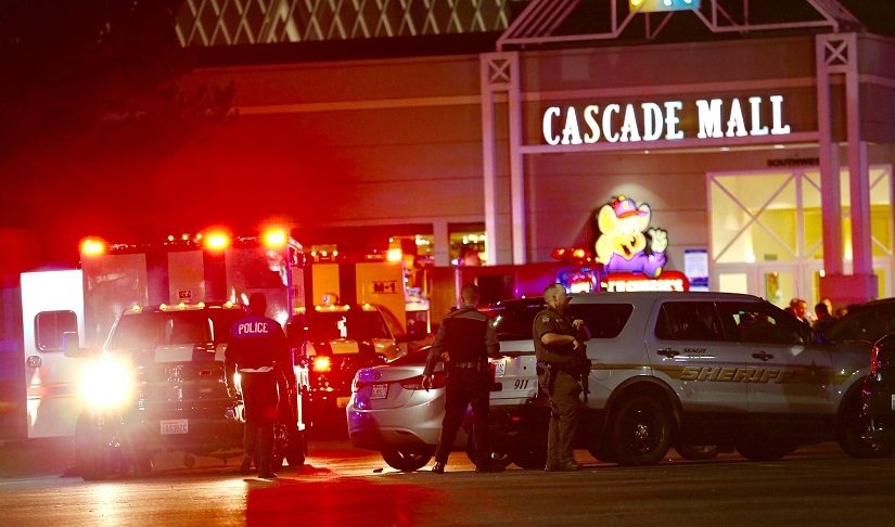 Law enforcement officers work at the crime scene outside of Cascade Mall in Burlington, Wash., where several people were fatally shot on Friday, Sept. 23, 2016. Authorities in Washington State say several people have been killed during a shooting at the mall north of Seattle and that at least one suspect remains at large. Sgt. Mark Francis says authorities are searching for a man wearing gray who was last seen walking toward Interstate 5 from the mall. (Dean Rutz/The Seattle Times via AP)