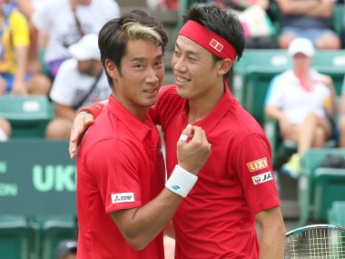 Japan's Kei Nishikori and Yuichi Sugita celebrate their win over Ukraine. AFP