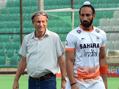 Coach Roelant Oltmans (left) with Sardar Singh. AFP file image