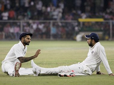 India Red players Shikhar Dhawan and Yuvraj Singh during the Duleep Trophy final match in Greater Noida on Tuesday.  PTI