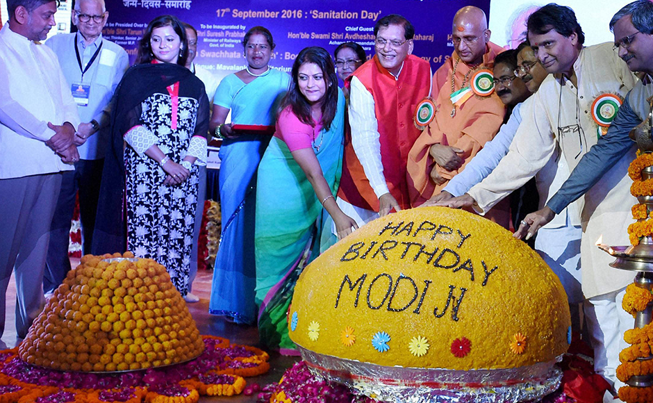 UnionMinister Suresh Parbhu unveils a Laddu at the inauguration of Swacchata Diwas function to mark the birthday of Prime Minister Narendra Modi at Mavlankar Hall in New Delhi on Saturday. PTI