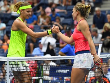 Simona Halep shakes hands with Lucie Safarova after beating her. Reuters