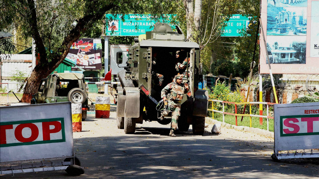 Soldiers rush to the attack site at Uri on Sunday. PTI