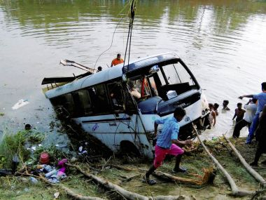 Rescue work in progress after a passenger bus fell into a pond at Benipatti in Madhubani district of Bihar on Monday. PTI