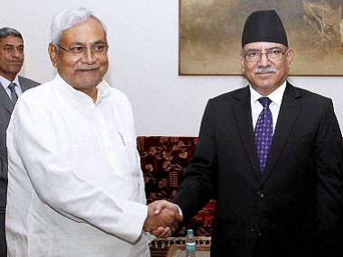 """Bihar chief minister Nitish Kumar shakes hands  with Nepal Prime Minister Pushpa Kamal Dahal """"aka Prachand""""a at  a meeting in New Delhi on Thursday. PTI"""