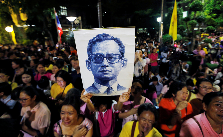 King Bhumibol Adulyadej, revered in Thailand as a demigod, breathed his last on Thursday. He was 88. Well-wishers of the King stood outside the hospital where he was being treated. Photo: Reuters