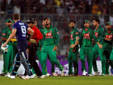 Bangladesh players exchange words with Jos Buttler. Reuters