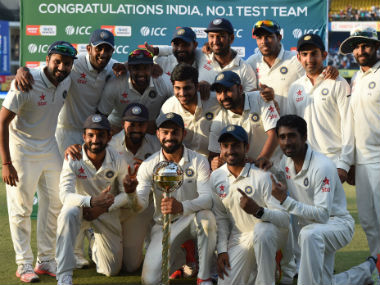 Indian players pose with the ICC Test Championship mace at Indore's Holkar Stadium. AFP