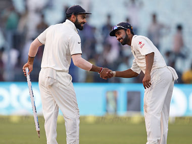 Virat Kohli and teammate Ajinkya Rahane congratulate each other after India's win. AP