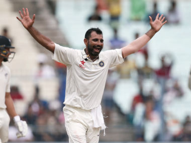Mohammed Shami celebrates after taking a wicket against New Zealand. AFP