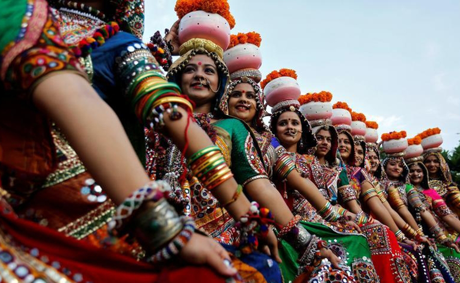 Women dressed in traditional attire pose after taking part in rehearsals for Garba, a folk dance, ahead of Navratri festival in Ahmedabad. Reuters