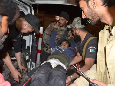 Pakistani volunteers and police officers rush an injured person to a hospital in Quetta. AP