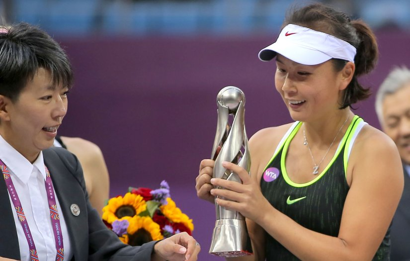 Peng Shuai of China looks at her trophy after winning the final match against Alison Riske at the Tianjin Open. AFP