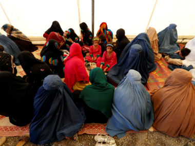 Afghan women after arriving at a UNHCR centre. Reuters