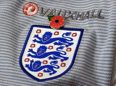 England's midfielder Jordan Henderson wears a poppy on his shirt in honour of Remembrance Day. AFP