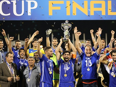 Iraq's Air Force Club celebrate with the AFC Cup trophy. AFP