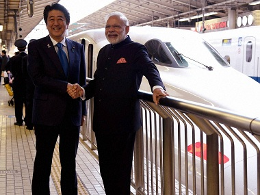 Tokyo : Prime Minister Narendra Modi shakes hands with his Japanese counterpart Shinzo Abe as he prepares to travel by Shinkansen bullet train to Kobe from Tokyo Station in Japan on Saturday. PTI Photo by Shirish Shete(PTI11_12_2016_000012B)