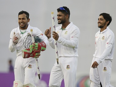 Bangladesh players celebrate their Test win over England. AP