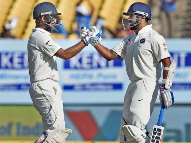 Murali Vijay and Cheteshwar Pujara congratulate each other on completion of their 200-run partnership on the third day of the first Test against England. PTI