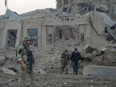 Afghan security forces and Nato troops investigate at the site of explosion near the German consulate office in Mazar-i-Sharif, Afghanistan. Reuters