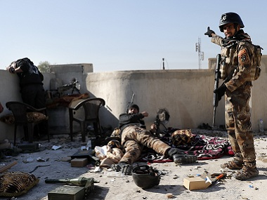 Members of Iraqi Special Forces fire towards a position of IS fighters. AFP