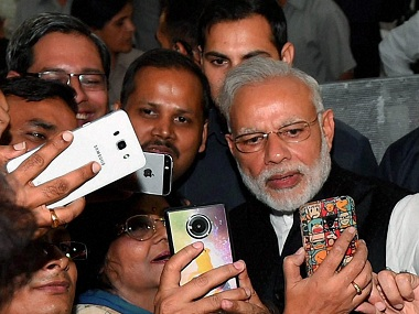 New Delhi: Journalists taking selfie with Prime Minister Narendra Modi during BJP's Diwali Mangal Milan Samaroh at party office in New Delhi on Thursday. PTI Photo by Shahbaz Khan(PTI11_3_2016_000297B)