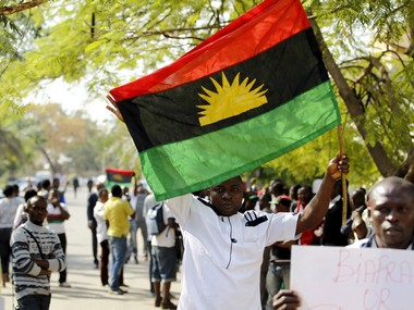 A supporter of Indigenous People of Biafra (IPOB) leader Nnamdi Kanu holds a Biafra flag. Reuters