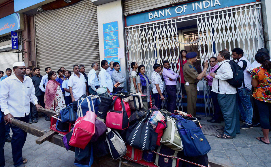 Long queues were witnessed at banks and ATMs, which opened after two days, as people rushed to get new banknotes in lieu of their old defunct bills. PTI