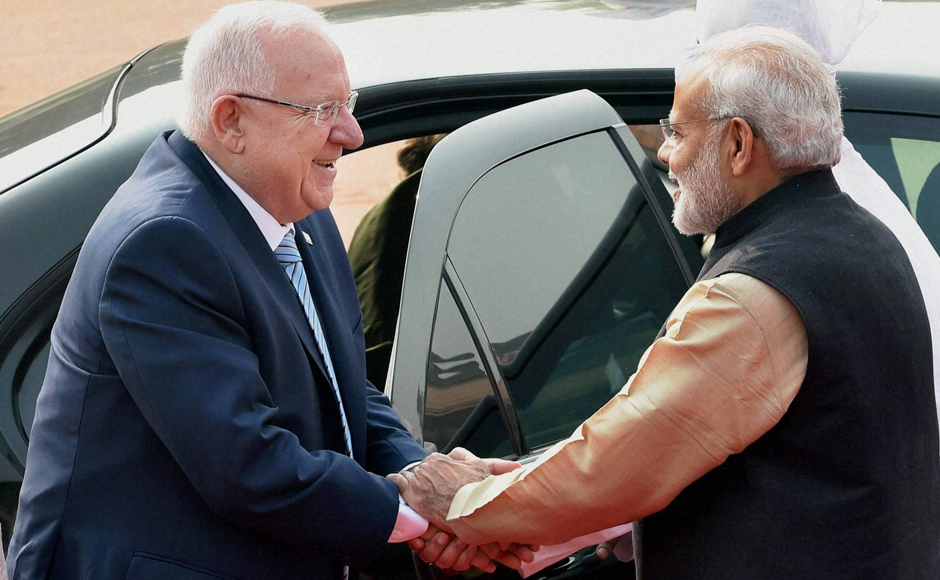 Prime Minister Narendra Modi shakes hands with Israeli President Reuven Rivlin during a ceremonial welcome at Rashtrapati Bhavan in New Delhi on Tuesday. PTI