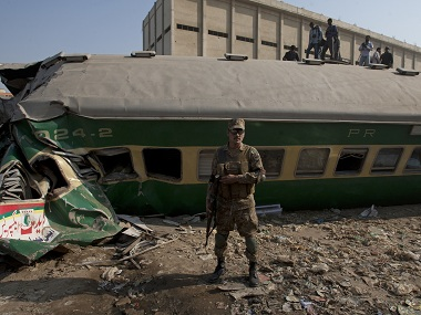 A Pakistani security personnel stands guard at the site of train accident which in Karachi, Pakistan, Thursday, Nov. 3, 2016. Pakistani officials say a train crash has killed dozens of people in the southern port city. (AP Photo/Shakil Adil)