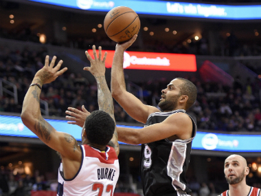 San Antonio Spurs' Tony Parker (R) during the match against Washington Wizards. AP
