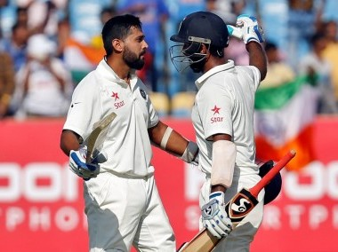 India's Murali Vijay is congratulated by Cheteshwar Pujara after scoring his century. Reuters