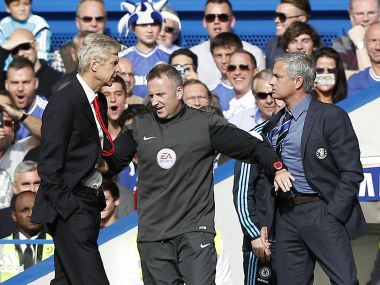 Jose Mouright (right) and Arsene Wenger. AFP