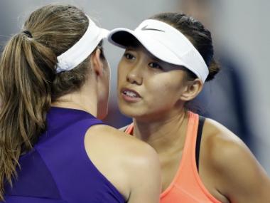 Zhang Shuai was congratulated by Konta after her win. AP