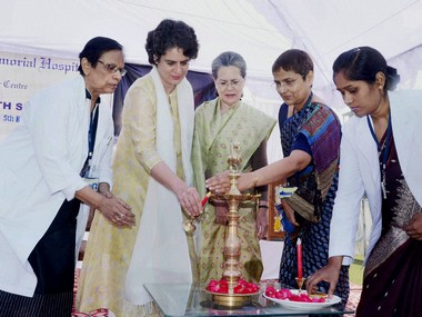 Priyanka Vadra lights a lamp during the inauguration of a seminar at  Kamla Nehru Memorial Trust hospital and cancer research center in Allahabad on Tuesday. Congress president Sonia Gandhi is seen. PTI