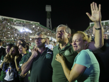 Relatives of Chapecoense's players say tearful prayers inside at the home stadium. AP