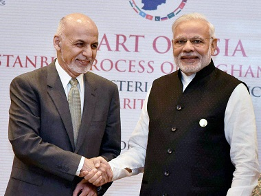 Prime Minister Narendra Modi and Afghan President Ashraf Ghani shake hands during Sixth Heart of Asia Conference in Amritsar on Sunday. PTI