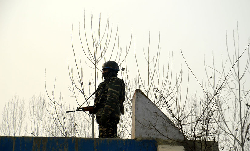 A soldier on patrol during the operation in Anantnag. Firstpost/Sameer Yasir