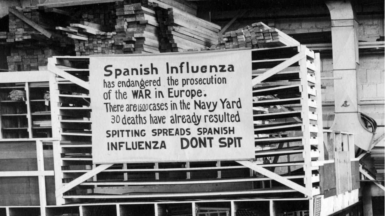 In this Oct. 19, 1918 file photo provide by the U.S. Naval History and Heritage Command a sign is posted at the Naval Aircraft Factory in Philadelphia that indicates, the Spanish Influenza was then extremely active. Image credit: U.S. Naval History and Heritage Command via AP